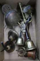 A BOX CONTAINING A SELECTION OF DOMESTIC BRASS WARE to include bells