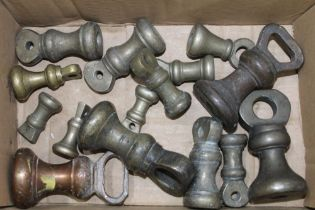 A BOX CONTAINING A SELECTION OF BRASS BELL WEIGHTS VARIOUS