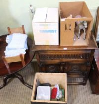 A TEA CHEST AND A BOX CONTAINING A SELECTION OF DOLLS HOUSE ACCESSORIES to include a bed and a