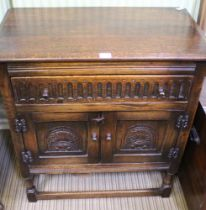 A GOOD QUALITY REPRODUCTION OAK FINISHED SIDE UNIT fitted carved front full width drawer, over two