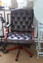 A REPRODUCTION FAUX LEATHER BUTTONED EXECUTIVES DESK CHAIR