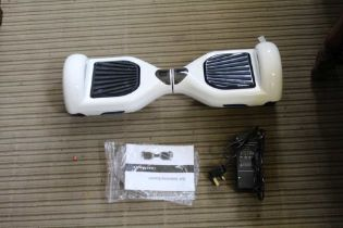 A BRAND NEW BOXED SEGWAY R2 being a self-balancing electric scooter, finished in white complete with