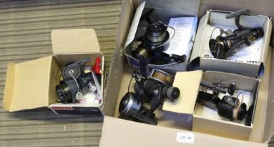 A BOX CONTAINING A SELECTION OF FISHING REELS