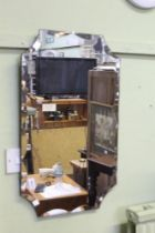 A 1930'S UNFRAMED SCALLOP BEVELLED EDGE WALL MIRROR