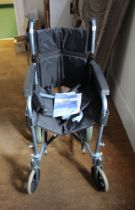 A FOLDING WHEELCHAIR manufactured through Days Healthcare, branded Escape Lite, with additional foot