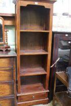 A MAHOGANY FINISHED IMPORTED HARDWOOD SET OF OPEN SHELVES the base having a single drawer
