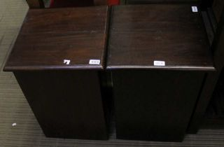 A PAIR OF MAHOGANY COLOURED IMPORTED HARDWOOD STORAGE DEVICES with lift-up lids & hollow bodies