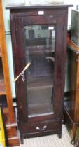 A MAHOGANY FINISHED IMPORTED HARDWOOD GLASS FRONTED SET OF SHELVES with single door, over a single