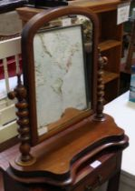 A 19TH CENTURY MAHOGANY ARCHED TOPPED ADJUSTABLE DRESSING TABLE TOP MIRROR on turned uprights &