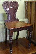 A 19TH CENTURY MAHOGANY HALL CHAIR with fancy shaped back & solid seat