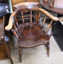 A 20TH CENTURY CAPTAIN'S ARMCHAIR with horseshoe back on a solid seat