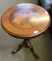 A REPRODUCTION CIRCULAR TOPPED WINE TABLE on turned column, and three downswept legs