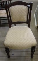 A 19TH CENTURY CARVED WALNUT SHOW WOOD FRAMED SINGLE CHAIR with trellis upholstered back & seat pad