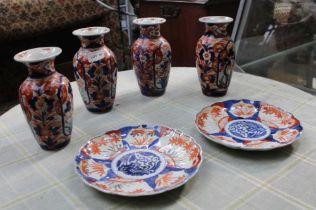 SIX PIECES OF JAPANESE IMARI PORCELAIN, four vases & two plates