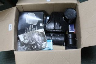 A BOX CONTAINING AN ORIGINAL CANON CAMERA together with lenses, filters, and other accessories