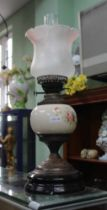 A METAL & POTTERY BASED OIL LAMP