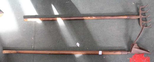 A COPPER MEASURE together with a plant sprayer, a wooden shafted rake, and a wooden shafted planter