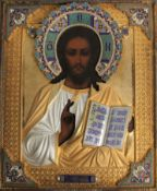 A Russian icon of Christ Pantocrator in a gilded silver and cloisonné enamel oklad, with enamelled