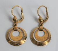 A pair of circle dropper earrings, marked 18ct gold, approx. weight 4.6gms. Important: Online