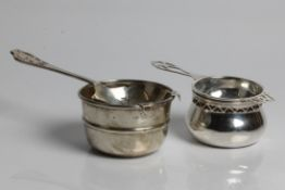 Two silver tea strainers, one with marks for Sheffield 1959 and 1963 and Emile Viner, one with marks