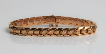 A yellow gold articulated bracelet, marked 18k, approx. length 18cms, approx. weight 16.9gms.