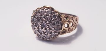 A yellow gold18ct diamond cluster ring of domed form set with 19 small diamonds, ring size R,