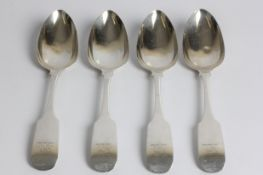A set of four George III silver tablespoons, with lion holding cross to handle, with marks for