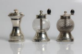 Silver and glass salt and pepper mills, with marks for Birmingham 1896 and Hukin & Heath, 9cm x