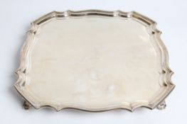 A silver tray with pie crust edge and antelope head engraved to front, with marks for Sheffield 1929