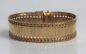 A tri-gold articulated bracelet, marked 750, approx. length 19cms, approx. weight 34.4gms.