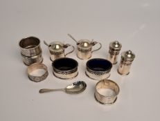 A collection of hallmarked silver to include, a cruet set comprising a pair of pepperettes, two