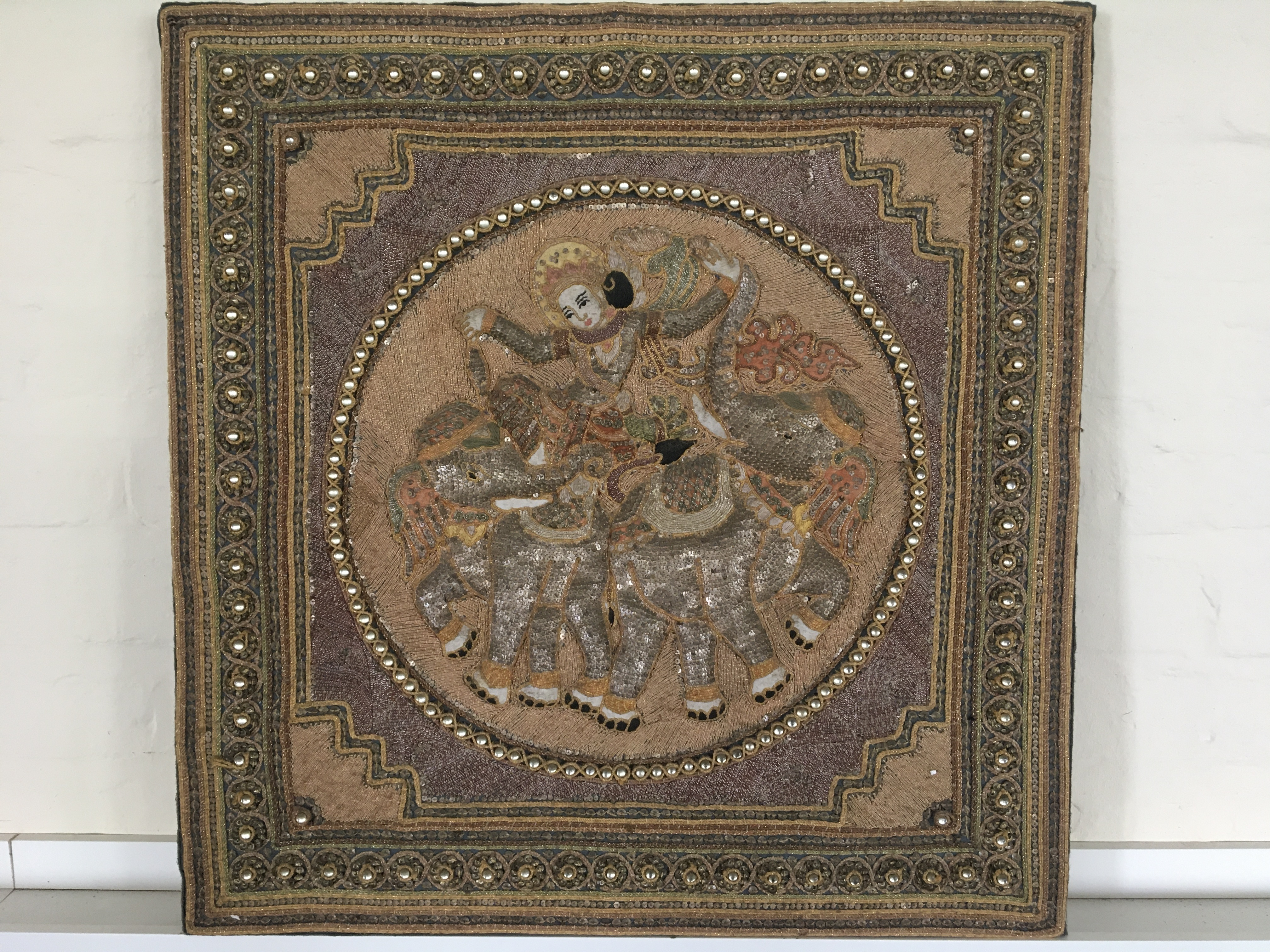 An Indian embroidered panel depicting female dancer on elephants with metal sequins and glass beads,