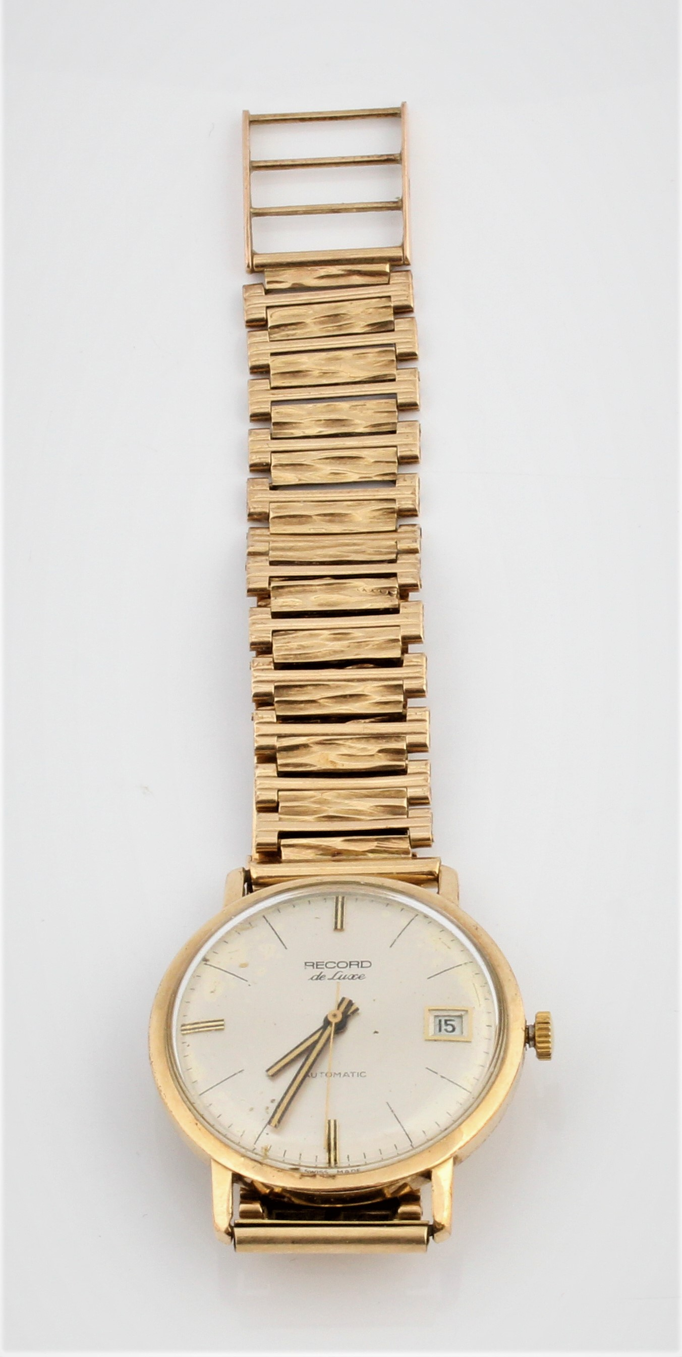A gents Record De Luxe wristwatch, the champagne dial having hourly baton markers with date