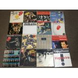 Eighteen Rolling Stones vinyl records (thirteen 12 inch singles), Going To a Go Go (x2), Time Is