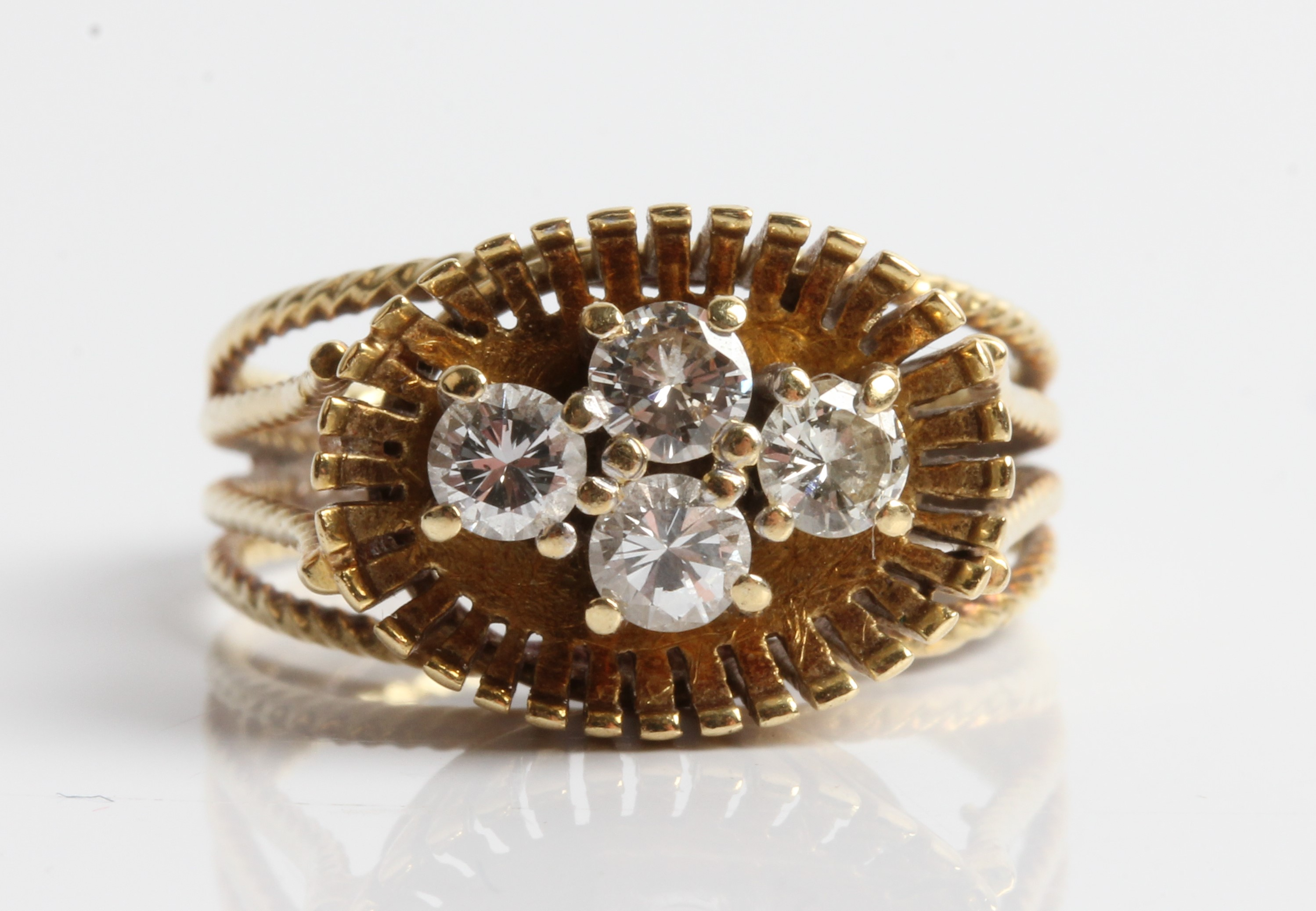 A diamond cluster ring, set with four round brilliant cut diamonds, each 0.15ct, in a raised gallery
