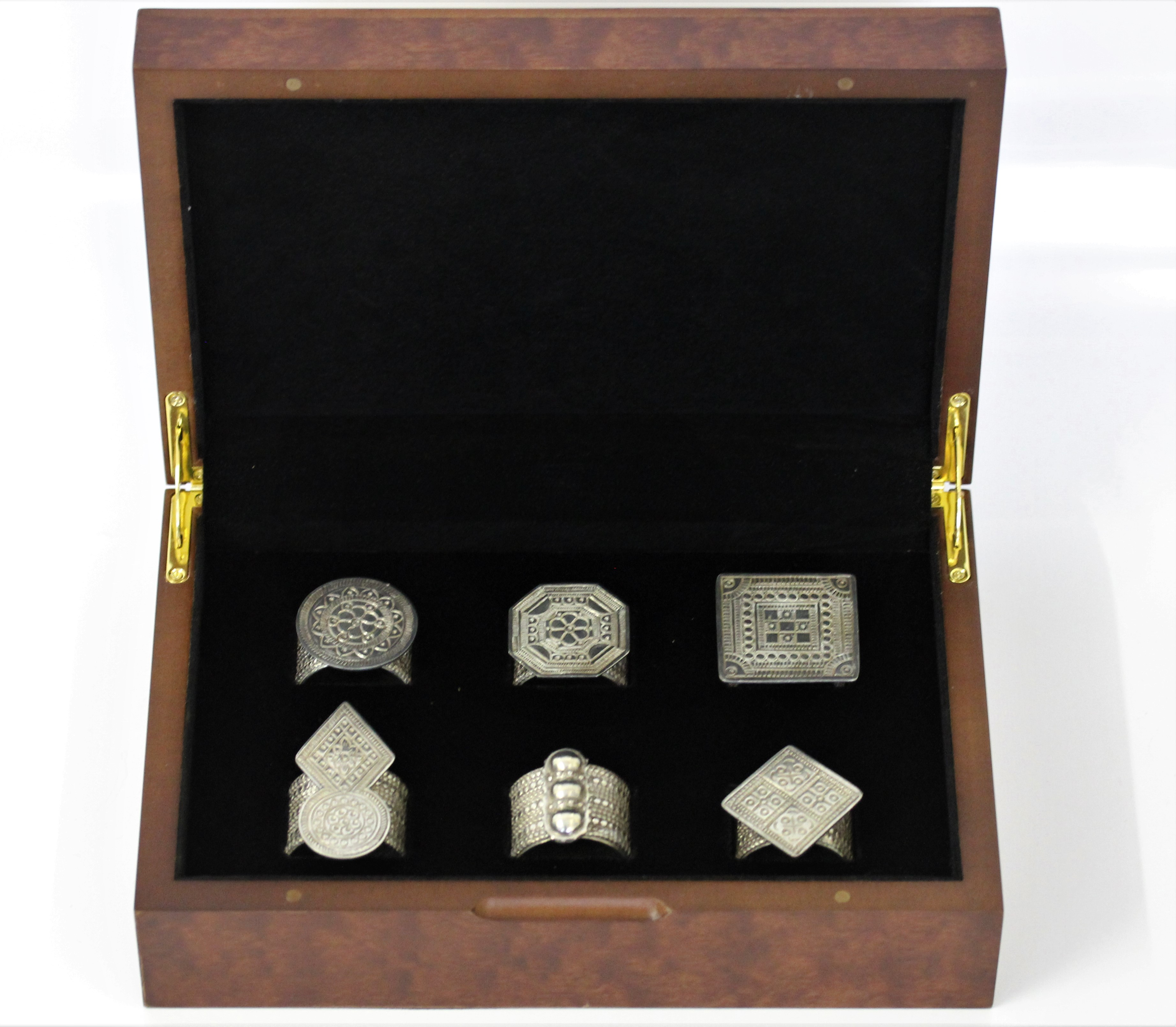Six various patterned napkin rings based on traditional Omani rings, housed in fitted box from