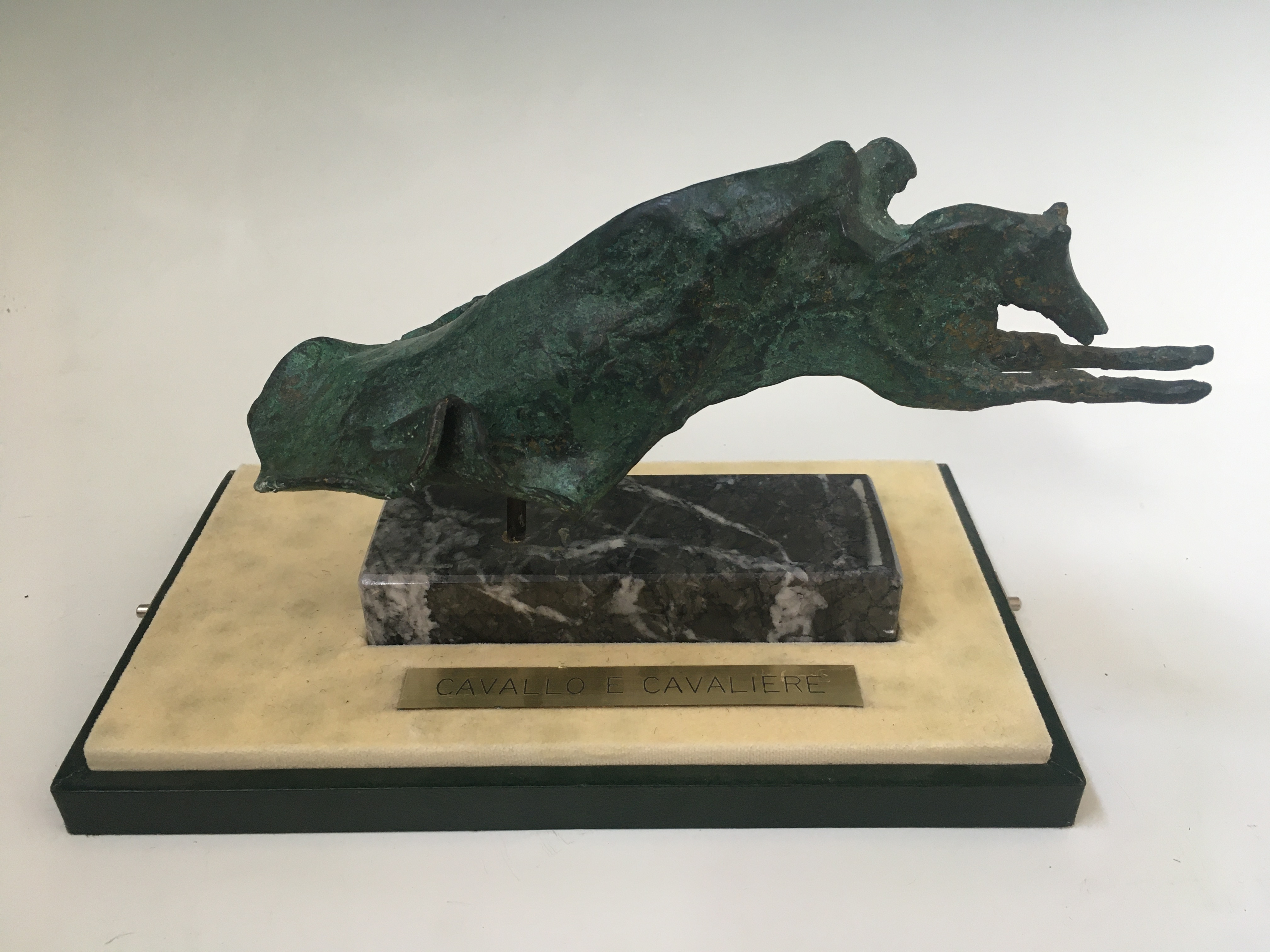 A bronze sculpture of man on horse, mounted on marble, inscribed to mount 'Cavallo E Cavaliere',