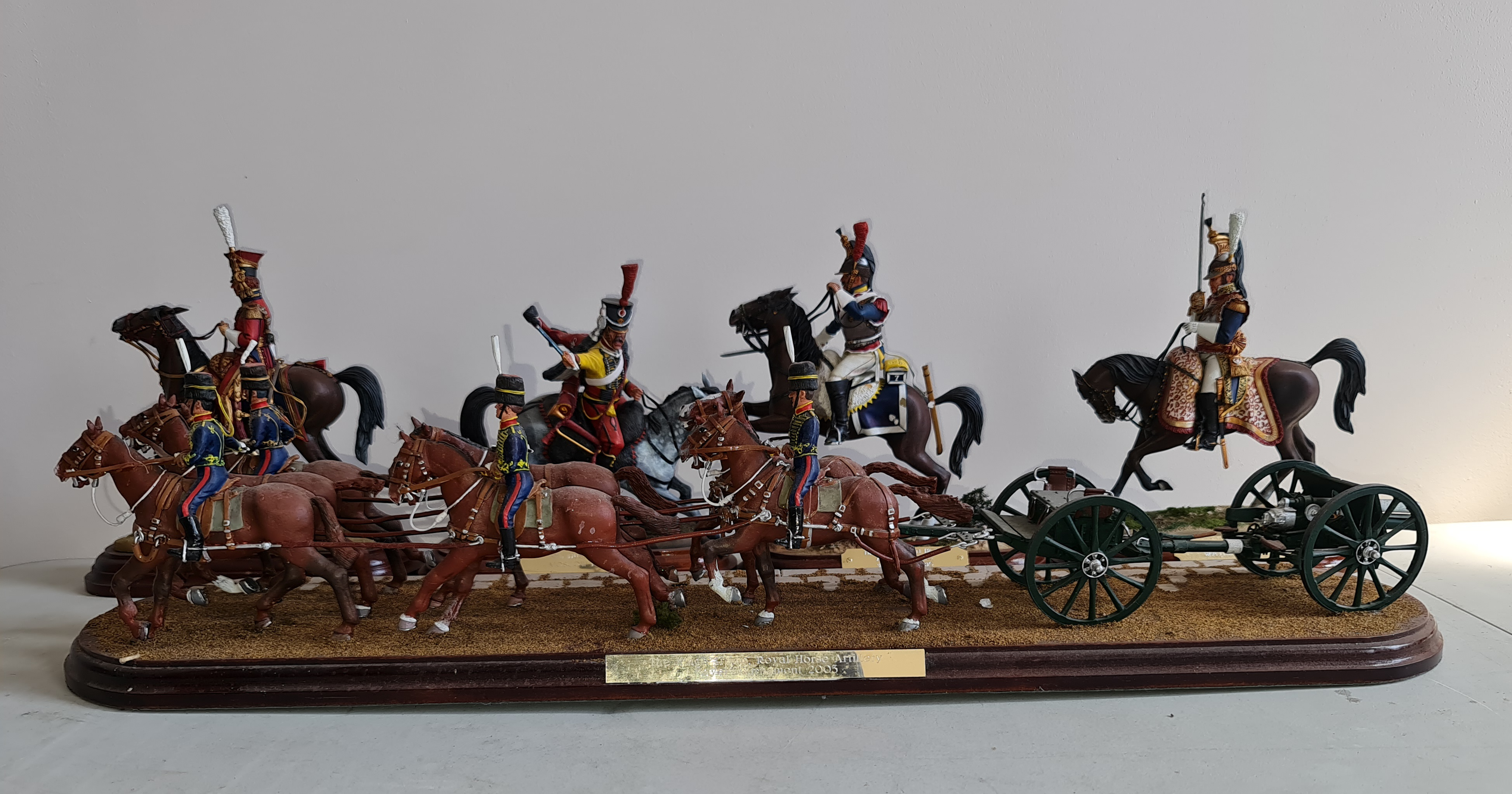A handpainted metal figure group mounted on wood, 'The Kings Troop, Royal Horse Artillery, Royal