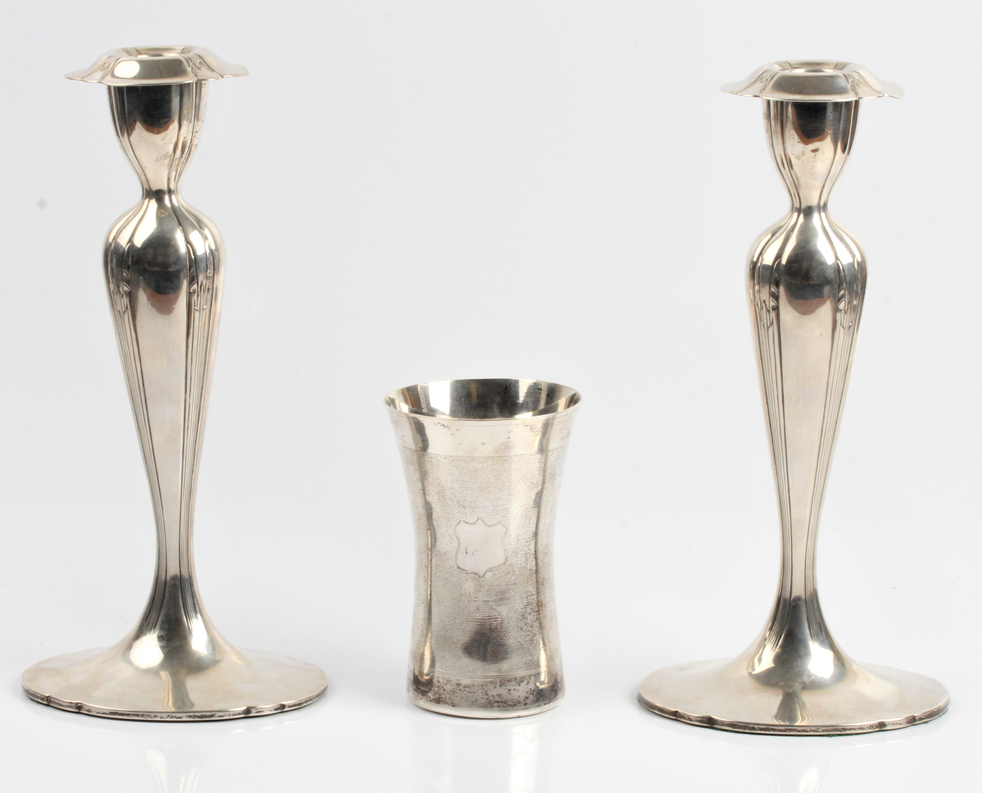 A white metal engraved beaker, approx. height 12cm, approx. weight 184g, together with a pair of