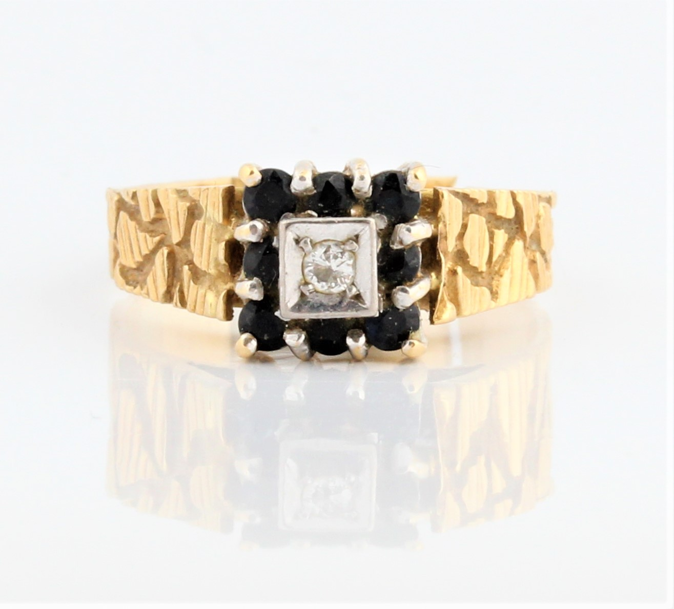 A sapphire and diamond square design ring, markings rubbed, ring size Q, weight approx. 5.2g.