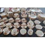 A Royal Albert old country roses dinner service and tea set with two tureens with lids.