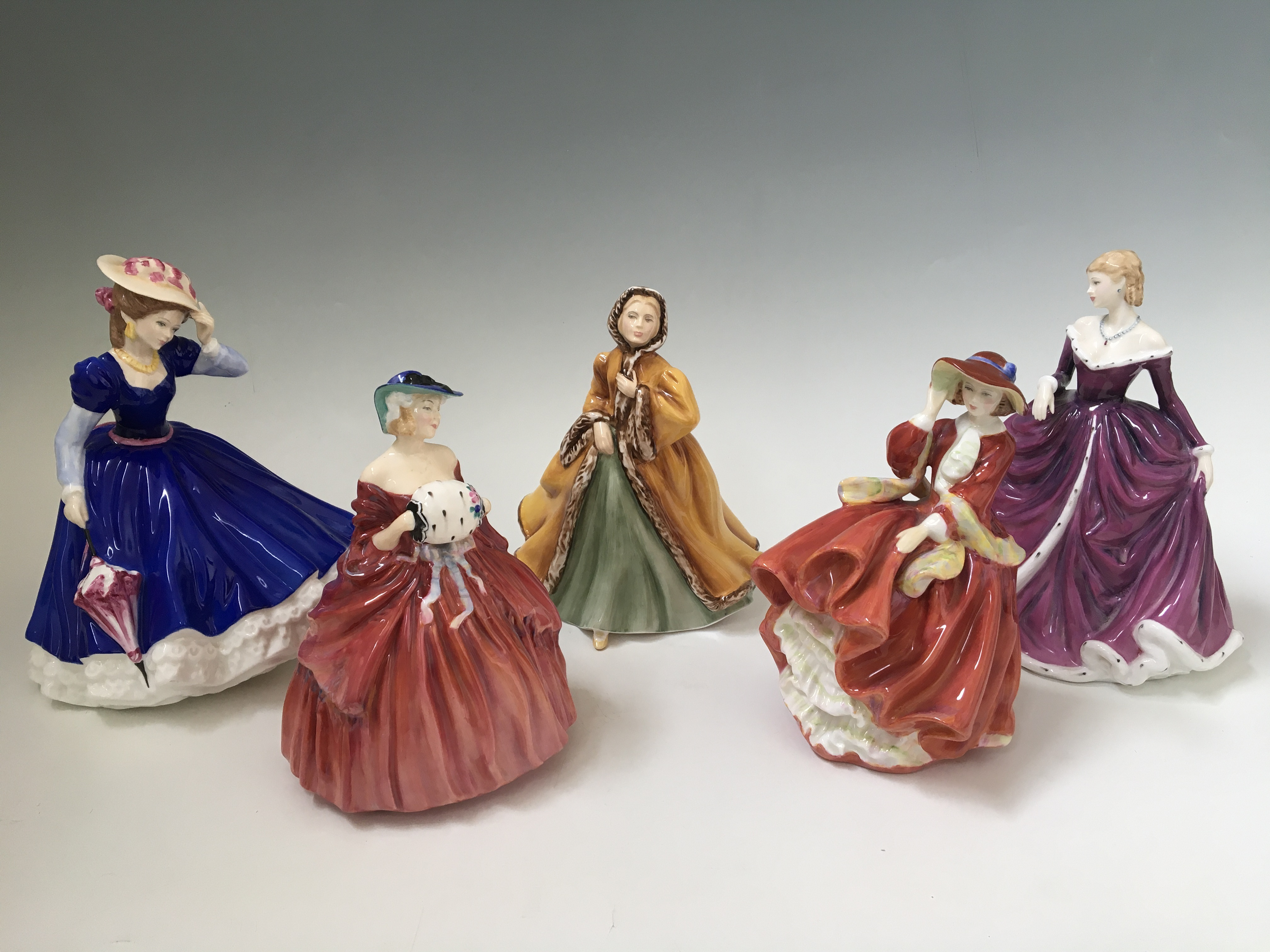 Five Royal Doulton figures, Top o' the Hill, Belle, Rachel, Genevieve and Mary. IMPORTANT: Online