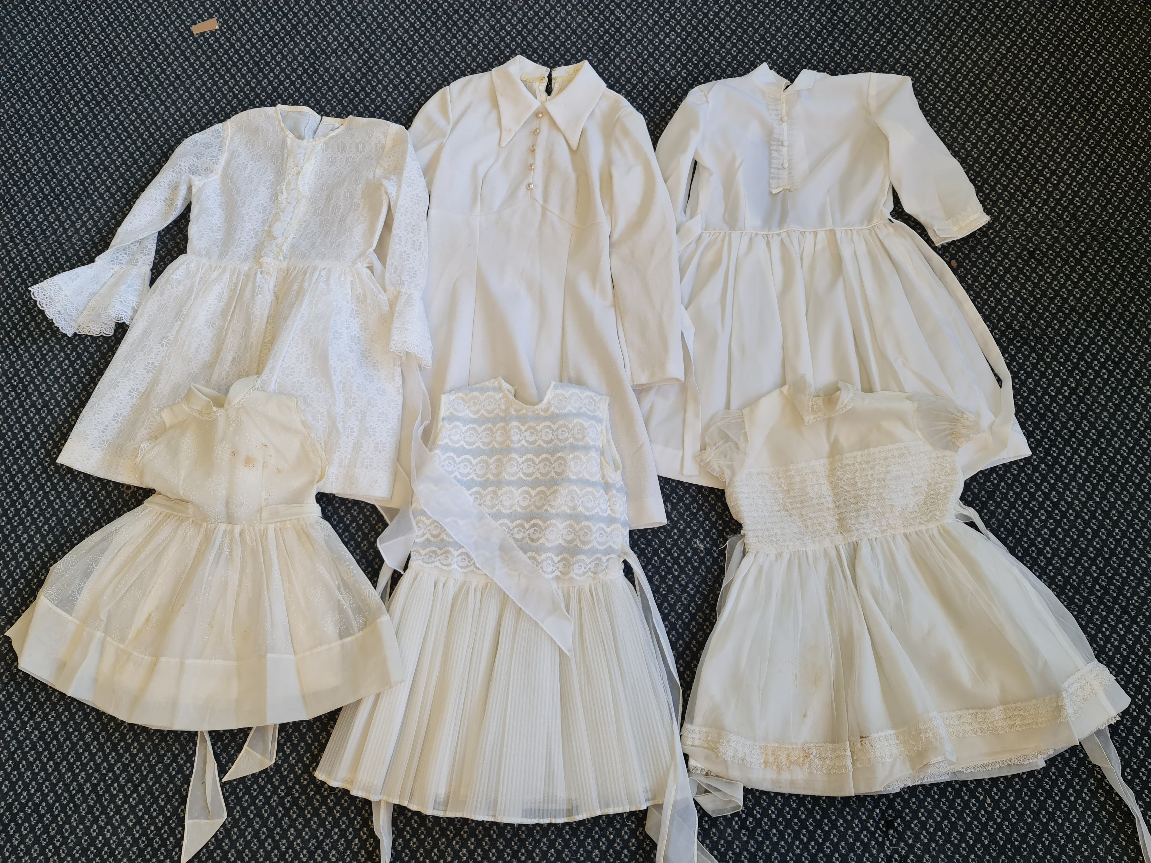 Six white 1960s May Day children's dresses. IMPORTANT: Online viewing and bidding only. No in person