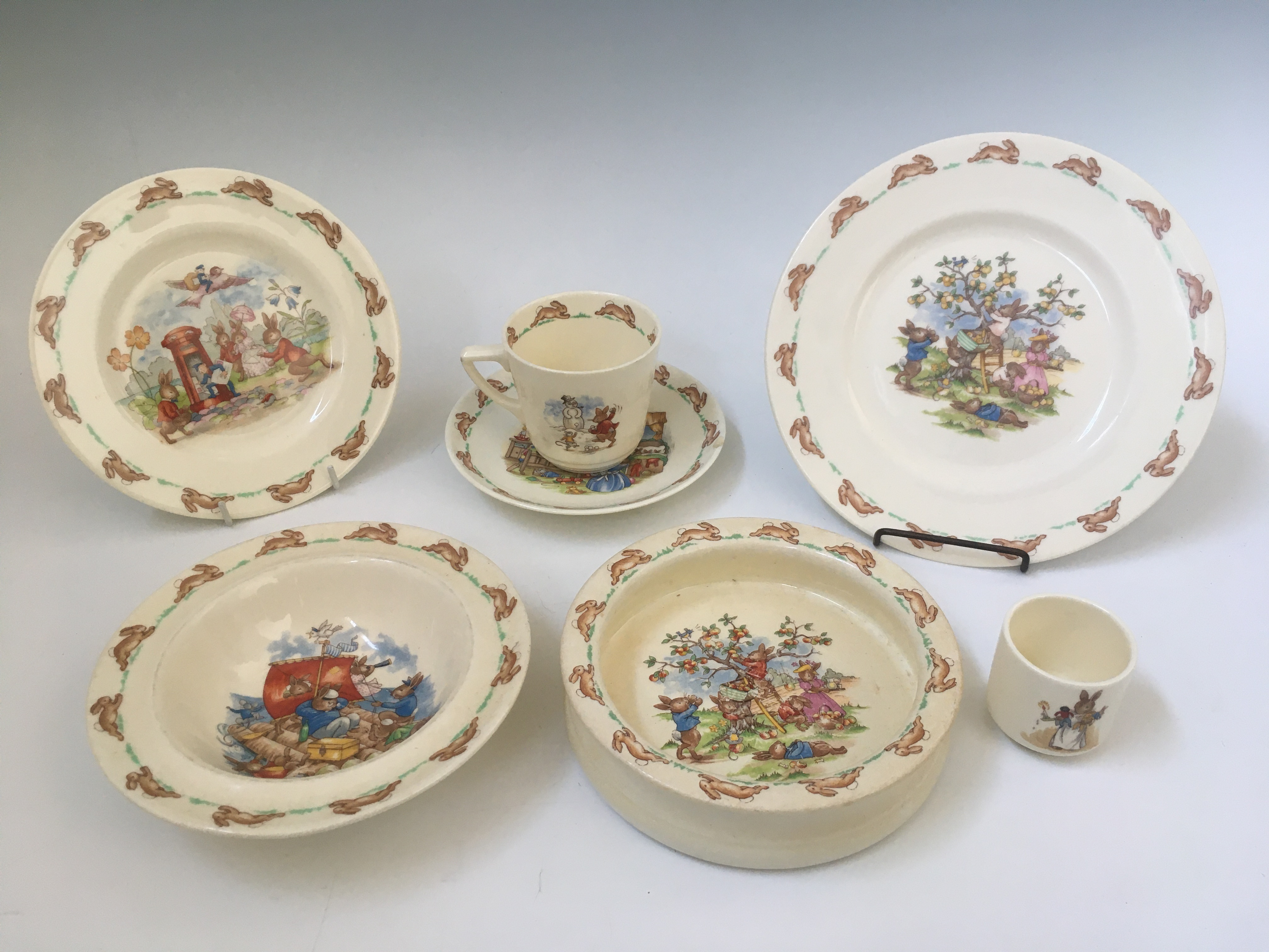 A part Royal Doulton Bunnykins breakfast set, to include cup, bowls, eggcup, seven pieces in