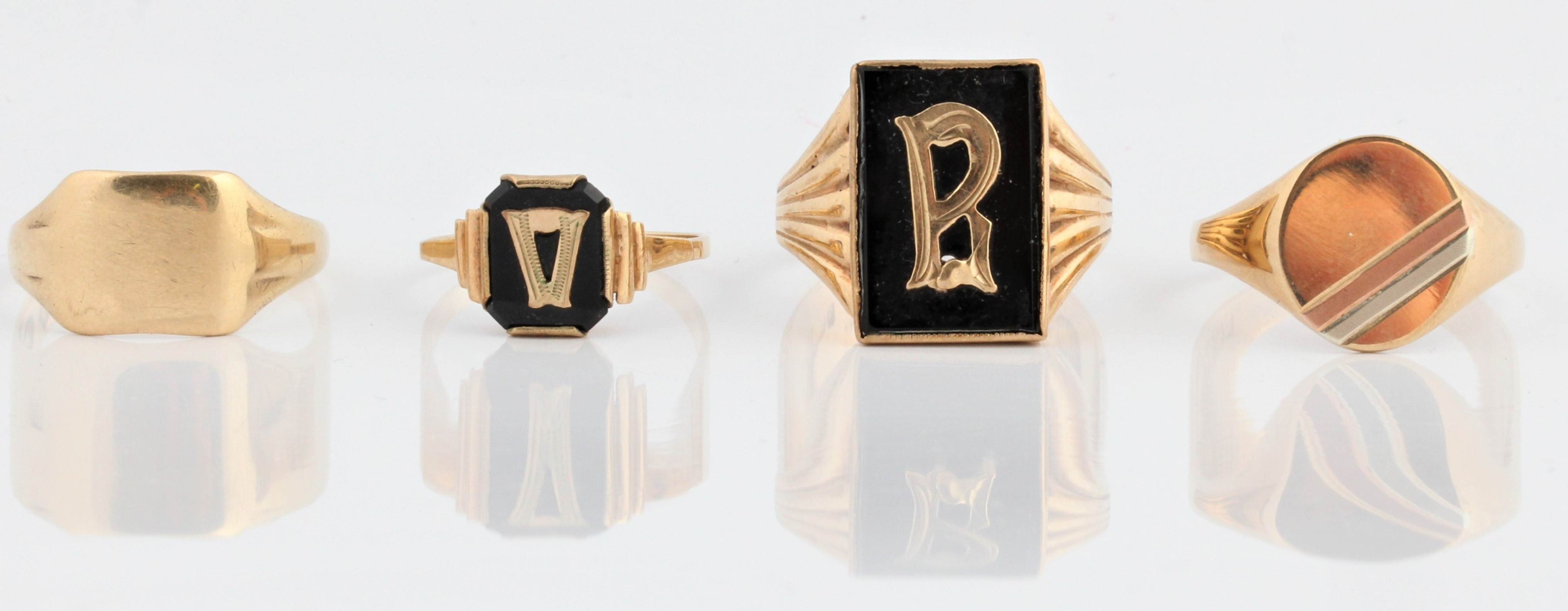 A selection of rings, to include a black hard stone mourning ring, stamped 9ct, ring size M½, a