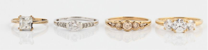 Four colourless stone rings, three hallmarked 9ct gold, the other unmarked yellow metal, ring