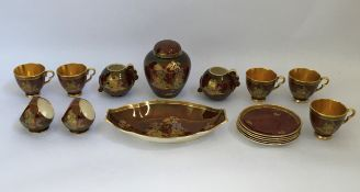 A Crown Devon part tea service with gold and burgundy oriental style design, including cups,