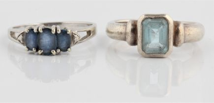 A hallmarked 9ct white gold three stone tanzanite ring, ring size P½, together with a blue topaz