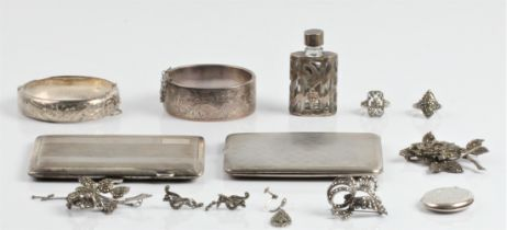 A collection of hallmarked silverware, to include a cigarette case, two hinged bangles and a locket,