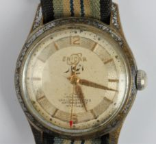 A gents ENICAR wrist watch, the gold-tone dial having hourly baton markers with 12 and 6 o'clock